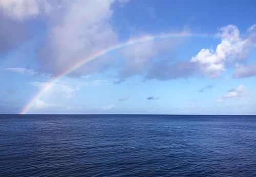 Rainbow over Caribbean ocean seen on Broadreach summer teen sailing camp