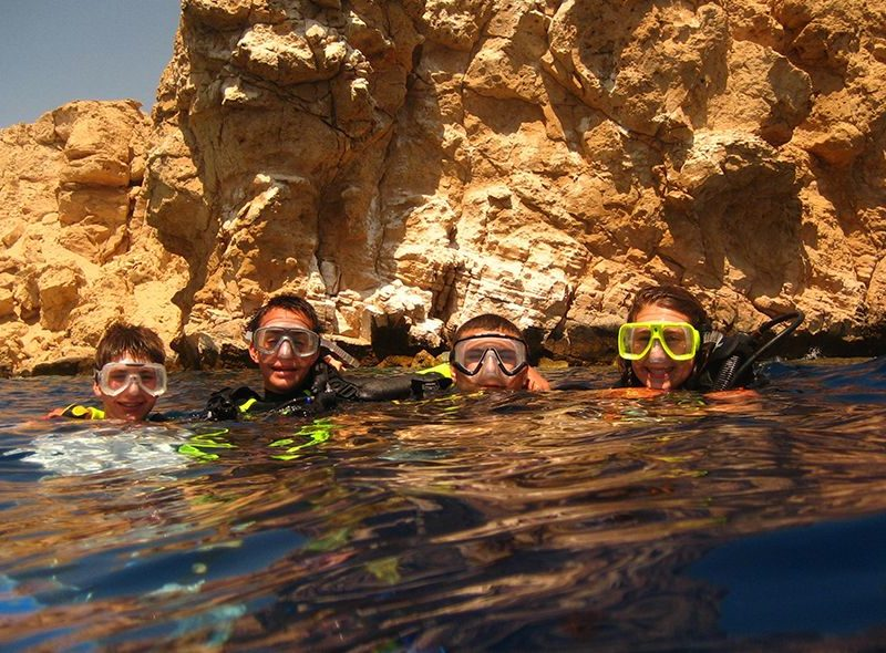 Teens diving in red sea on scuba summer camp