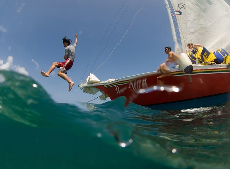 Student jumping into ocean from Broadreach Caribbean sail boat